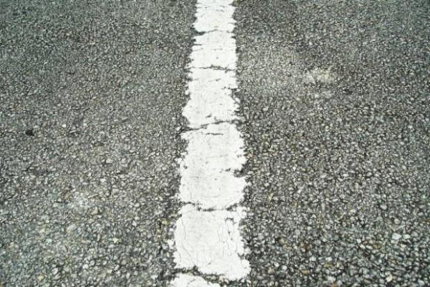 Trwa asfaltowanie górnej warstwy odcinku C na A2